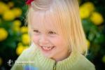 smiling girl yellow flowers