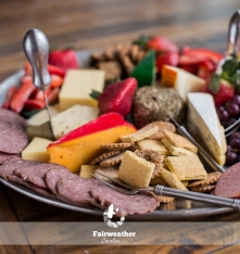 Imported cheese, wild game and summer sausage platter with fresh fruit